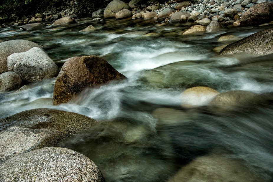 The river rocks rounded and smooth from countless years of rushing water all contribute to the co...