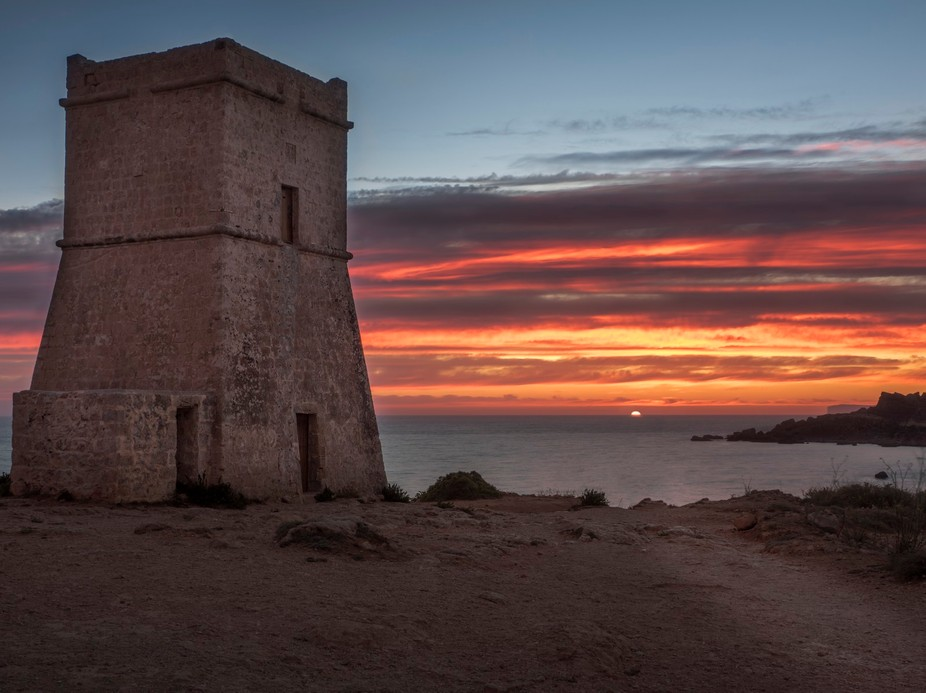 The last sunset for spring.  One of the many towers found around the Maltese coastline. Enjoy :)