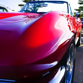 Vintage corvette at a car show perspective shot to show off the curves