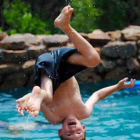 My grandson is perfecting his back somersault into the pool