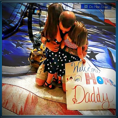 girls greet daddy coming home from afganistan