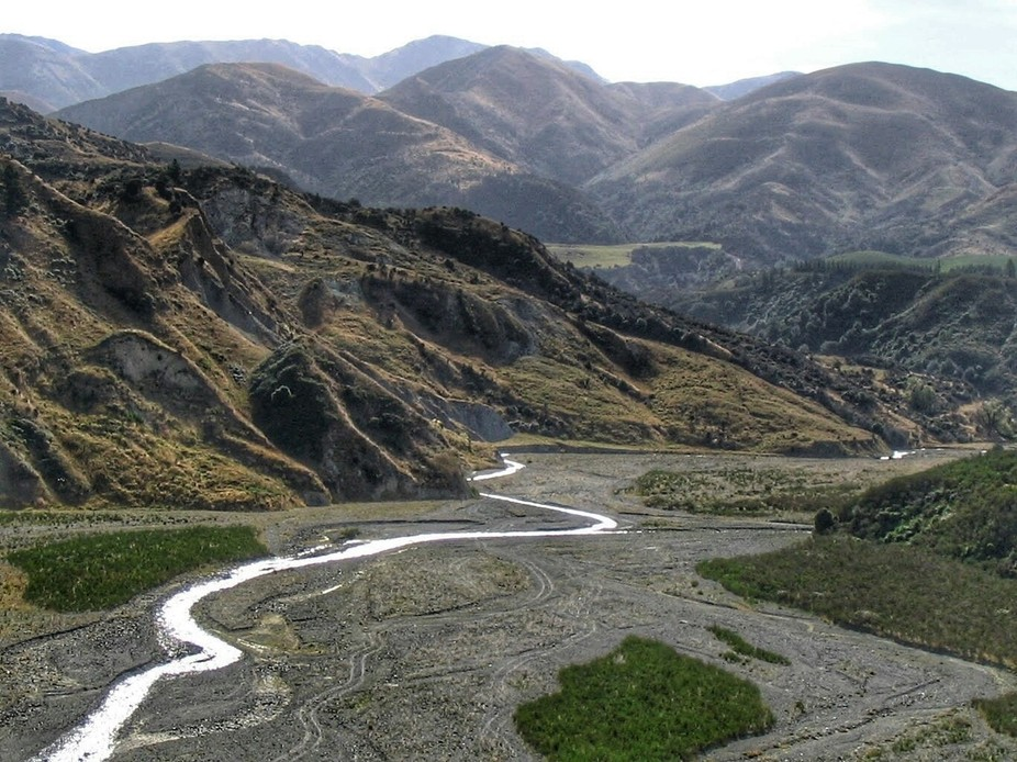This nearly dry riverbed is in Canterbury South Island NZ.