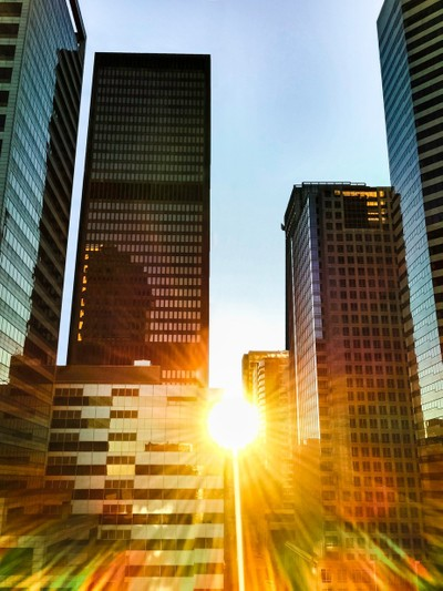 Big Sun Flare At Sunrise Between 2 Tall Buildings In Downtown Seattle WA