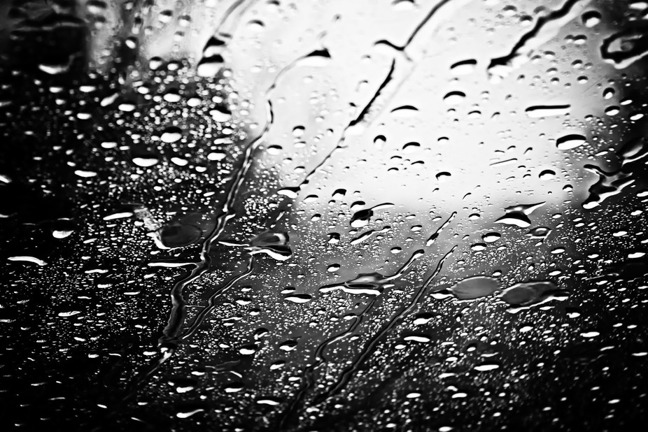 Rain on the windshield of a car. 2010.