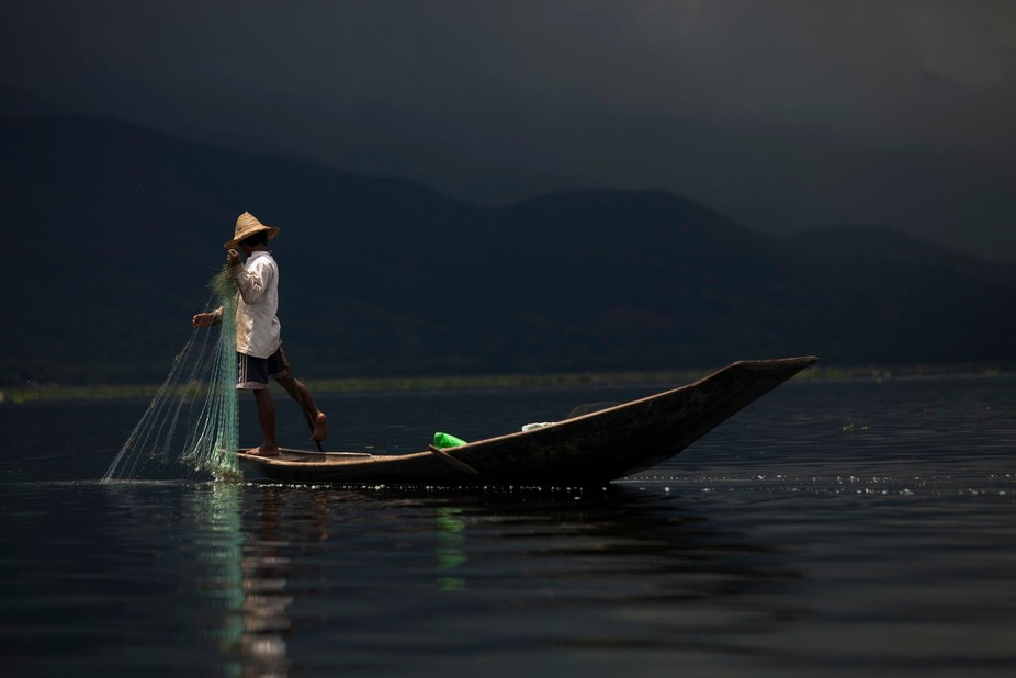 This is such a beautiful photo of the fishermen living around Lake Inle.  Here they use a pole wr...