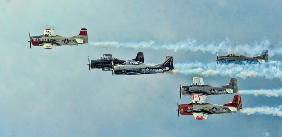 Vintage fighter planes performing during a military airshow