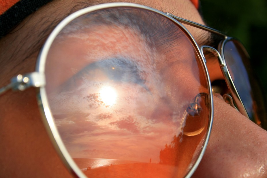 While on the beach, my friend was looking towards the sky and I noticed the reflection of the sun...