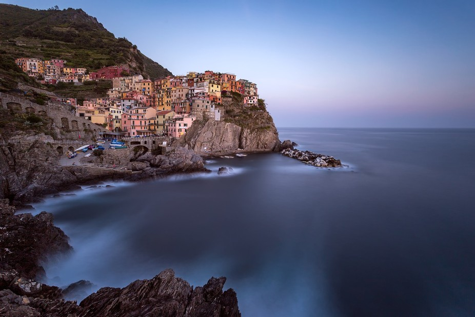 A peaceful calm falls over the Cinque Terre town of Manarola as the last light of the day fades o...