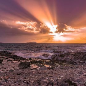 I captured this image of a setting Sun shining through approaching storm clouds and casting rays of light over the Atlantic Ocean whilst out tour...
