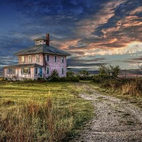 This is a color photograph of the pink house near Plum Island, MA. I used to drive by this house every day on my way to and from work and was alw...