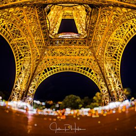 Night shot below the Eiffel Tower with a Sigma 15mm fisheye lens. Editing was done using On1 Photo and Adobe Lightroom.