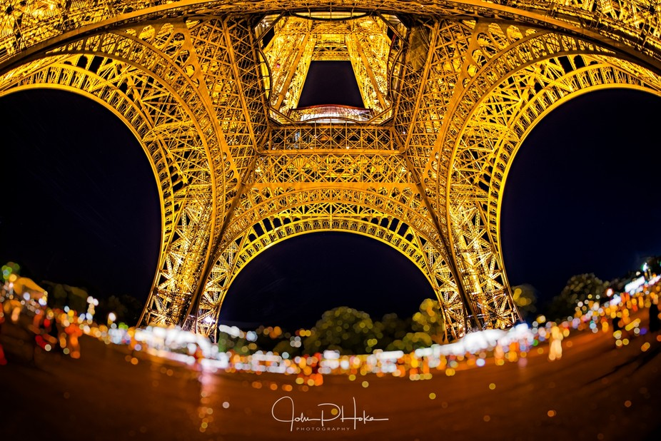 Night shot below the Eiffel Tower with a Sigma 15mm fisheye lens. Editing was done using On1 Phot...