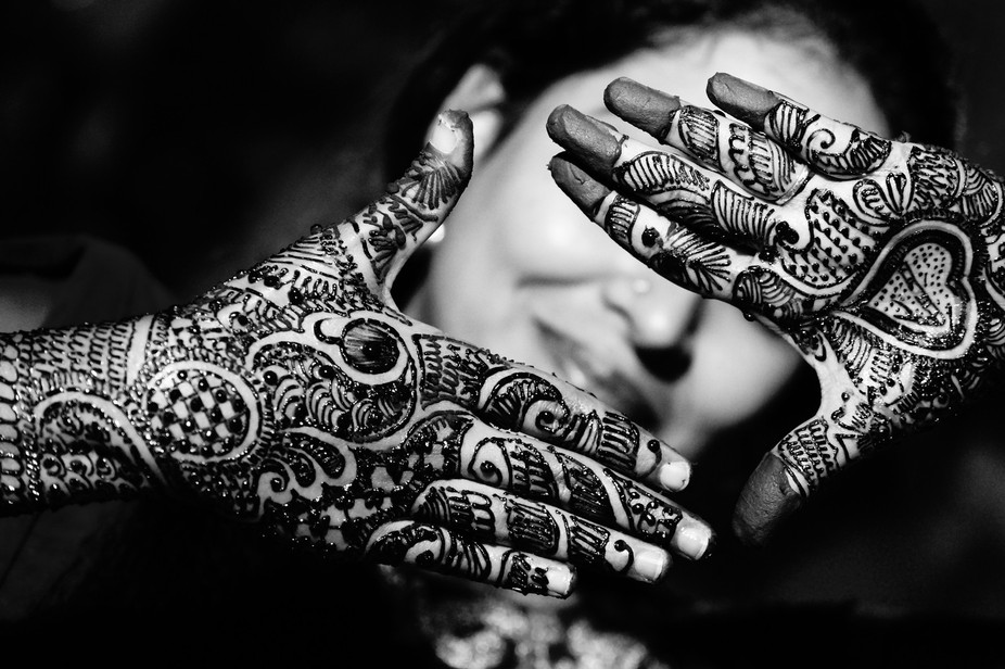 Mehendi shot of Indian bride this was straight out of the camera unedited.  Light source : street...