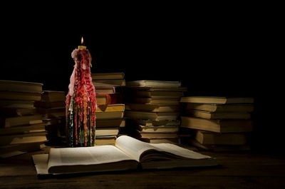 Night, books, candle.