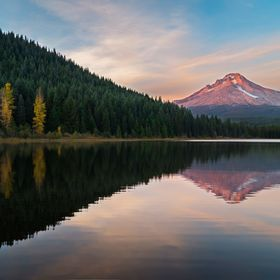Fall sunset on Trillium Lake at the heart of the Cascade Mountains, Mt Hood rises high above the lake with record low snow pack, Exposing the anc...