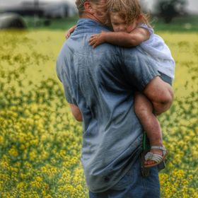 The little one grew tired of walking in the beautiful canola fields so she hitched a ride with dad.