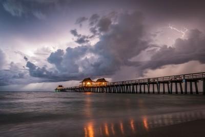 Night pier under storm