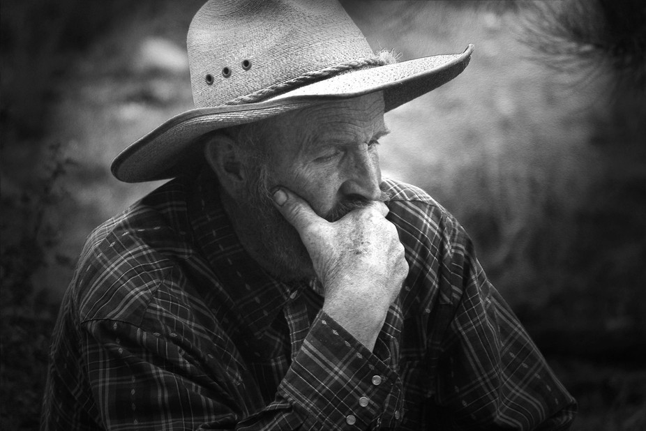 This photo was taken right before this old cowboy recited some poetry. He started into the flames...