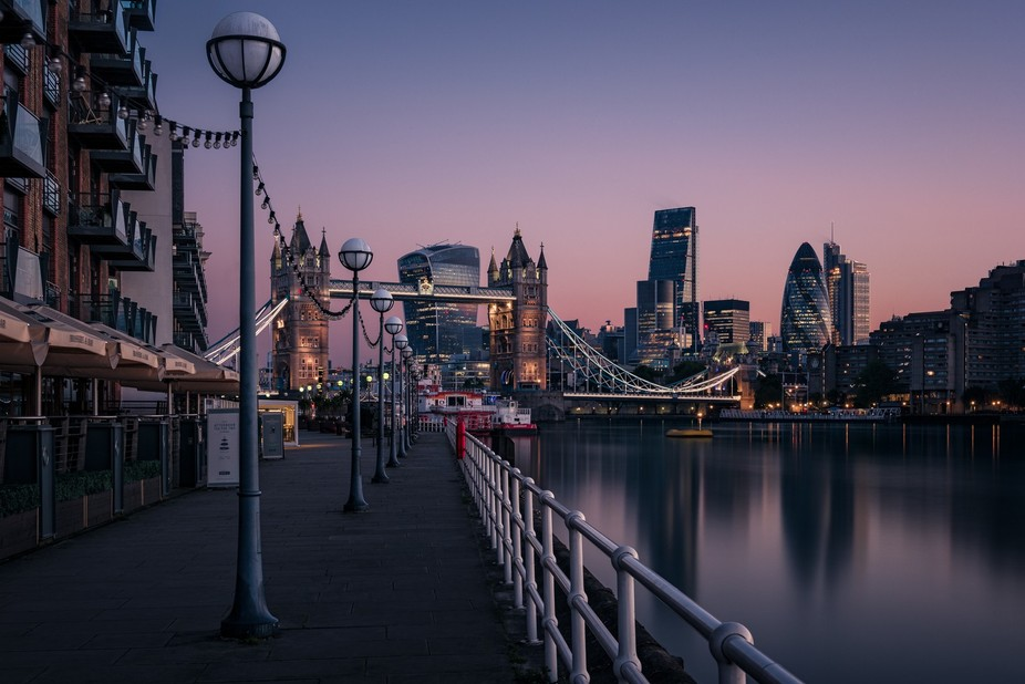 The beautiful Thames Path leading from Butler's Wharf to Tower Bridge at dawn.