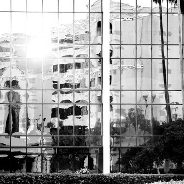 reflection building MONO with sunflare