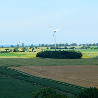 View of wind turbines from top of Church tower in Norfolk,UK.