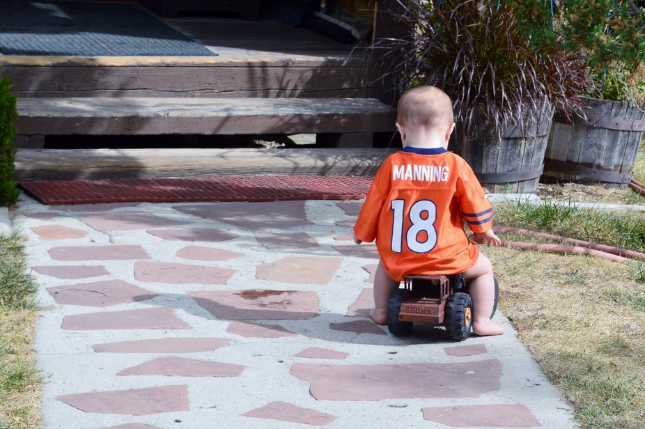 Teaching football....baby only knows everywhere he goes he see's orange and the #18