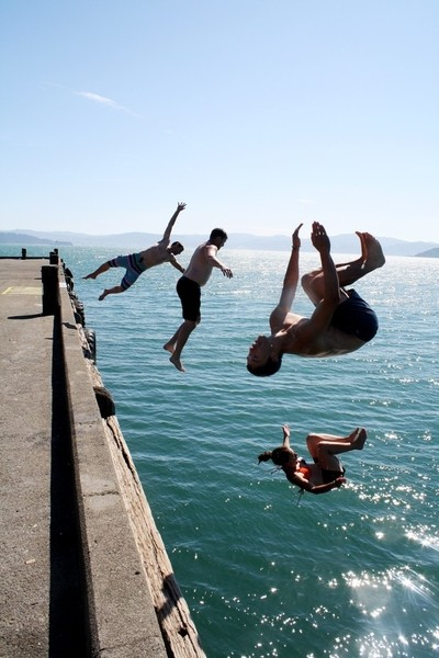 Friends jumping off the wharf