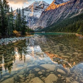 Mount Edith Cavell reflected in the calm river at sunrise in the rocky mountains of Jasper National Park, Alberta, Canada. Another Iconic Canadia...
