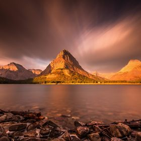 Sunrise in Glacier National Park. Long exposure with mount grinnell as a focal point at sunrise. clouds and smoke from forest fires created the d...