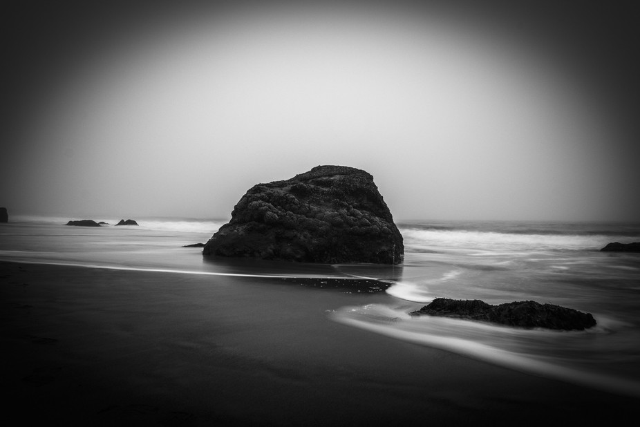 A surreal landscape highlighting the contrast between rough and smooth, and also opacity and refl...