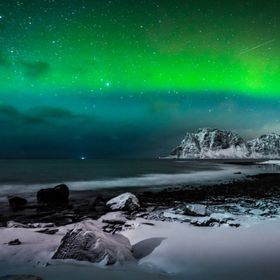 Low aurora activity over Uttakleiv Beach, Lofoten, Norway.