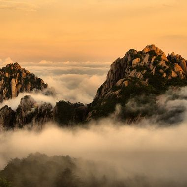"The Huangshan Mountains in China are noted for their fantastic cloud and rock formations, including the ""sea of clouds"" that can appear below their craggy peaks. These peaks floated in and out of the clouds that rose from below, almost like visions in a dream"