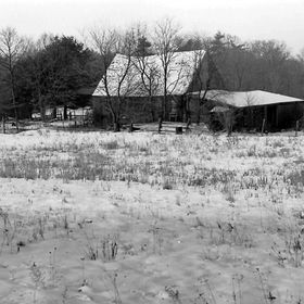 A friend's Farm, where I took hundreds of photos over the years.  The snow and the roof brings out the blacks.