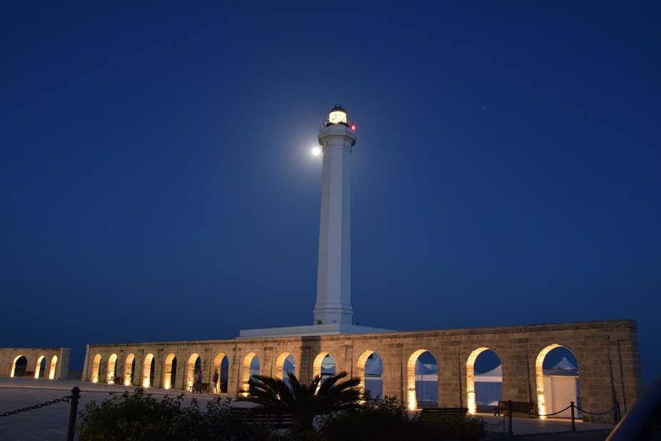 Moon playing hide and seek with Leuca lighthouse.