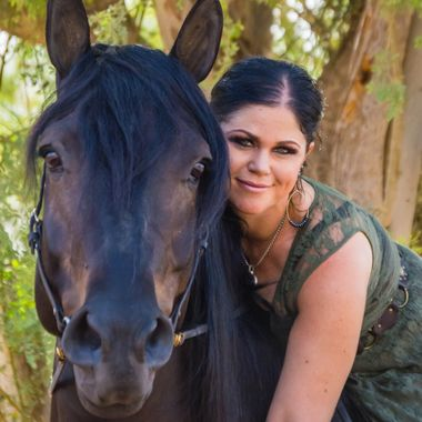 I wanted to capture the bond, trust and love between a woman and her horse.  I loved this horse, he knew when to look a the camera, ears perked up and I didn't even need to direct him; he was such a ham! :-)