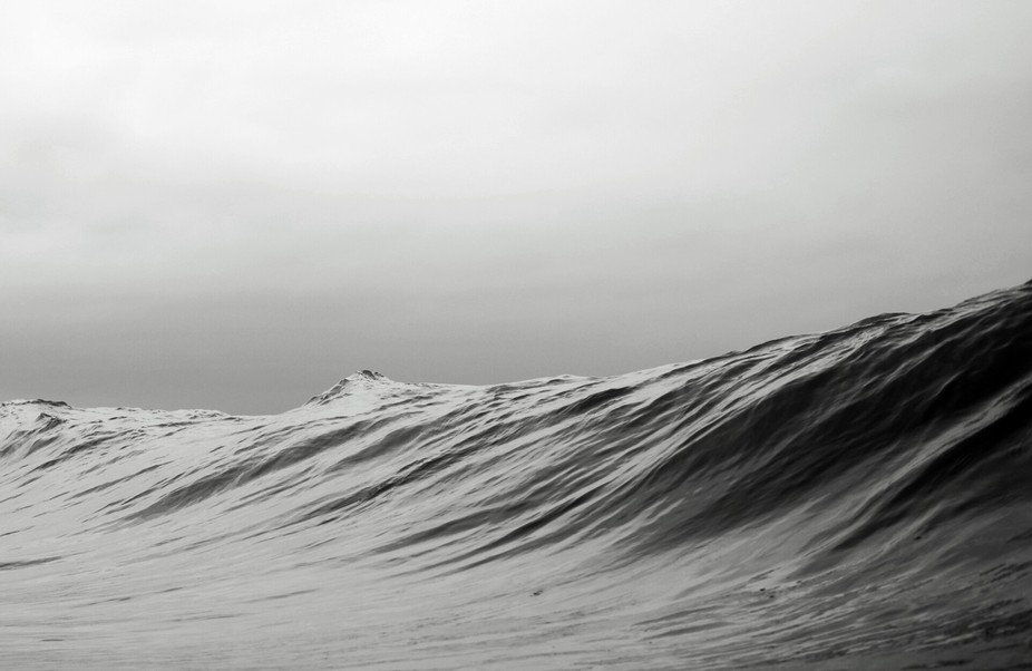 Just a normal wave photographed at midday on a slightly overcast day in Outer Banks, NC. The cond...