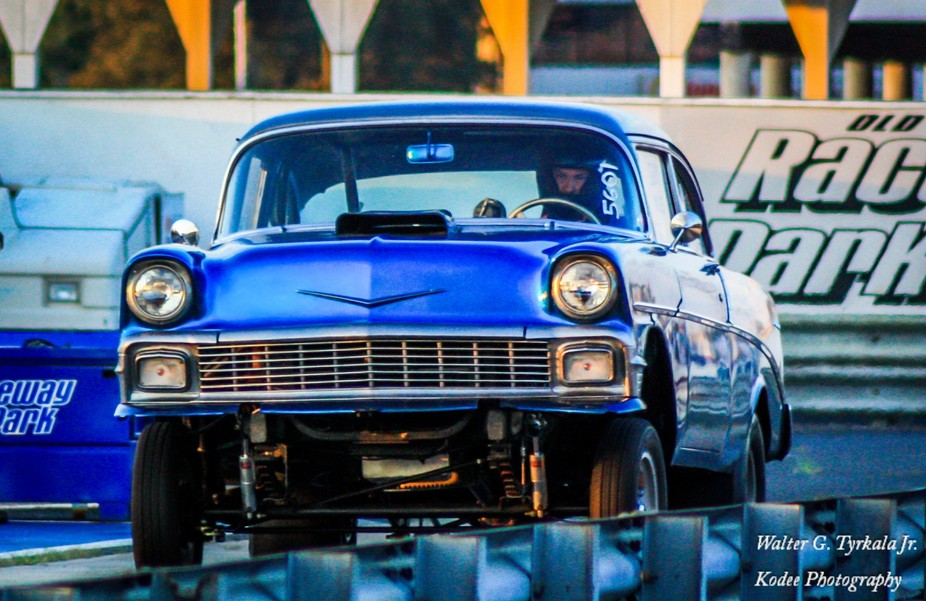 Taken at raceway Park, Englishtown, NJ, this '57 Chevy lifts its front wheels as the &am...