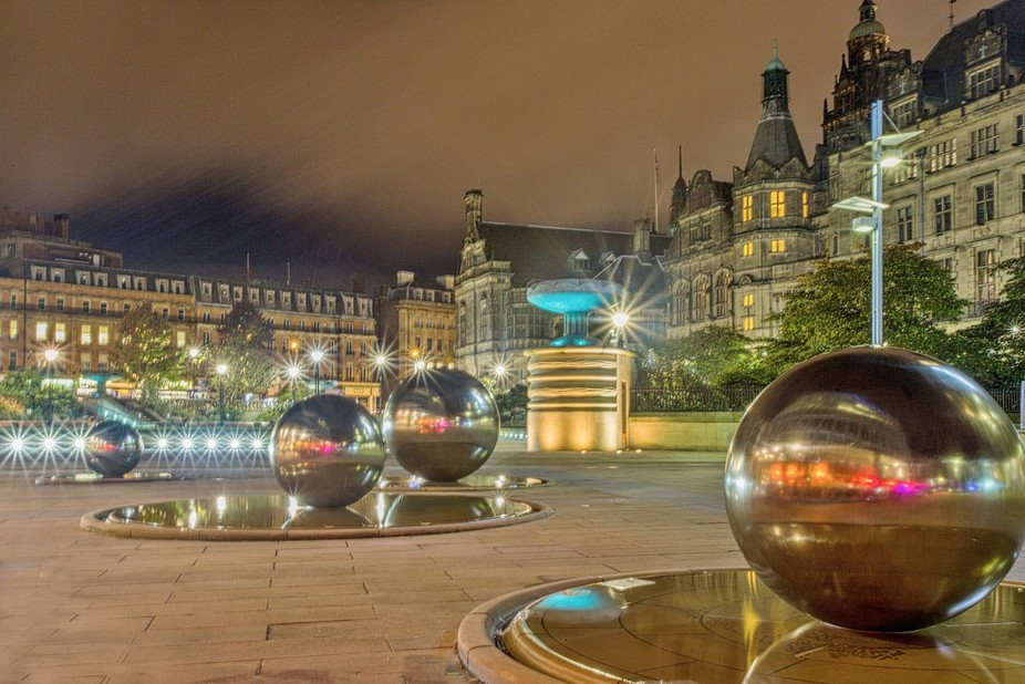 Old meets new in the reinvented Sheffield peace gardens in the UK.