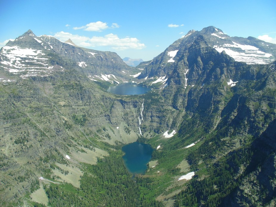 This was taken from a helicopter over Glacier National Park in Montana. Through the window,  and ...