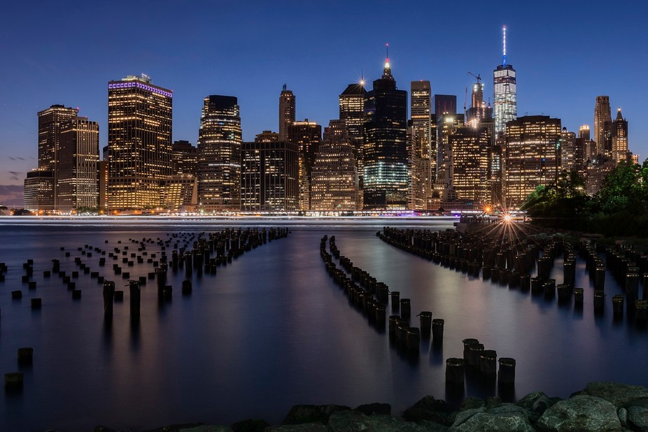 A number of photographers set up their tripods near the wood pylons in Brooklyn Bridge Park. I th...