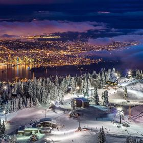 Panorama of Vancouver city, British Columbia from the summit of Grouse mountain at twilight.