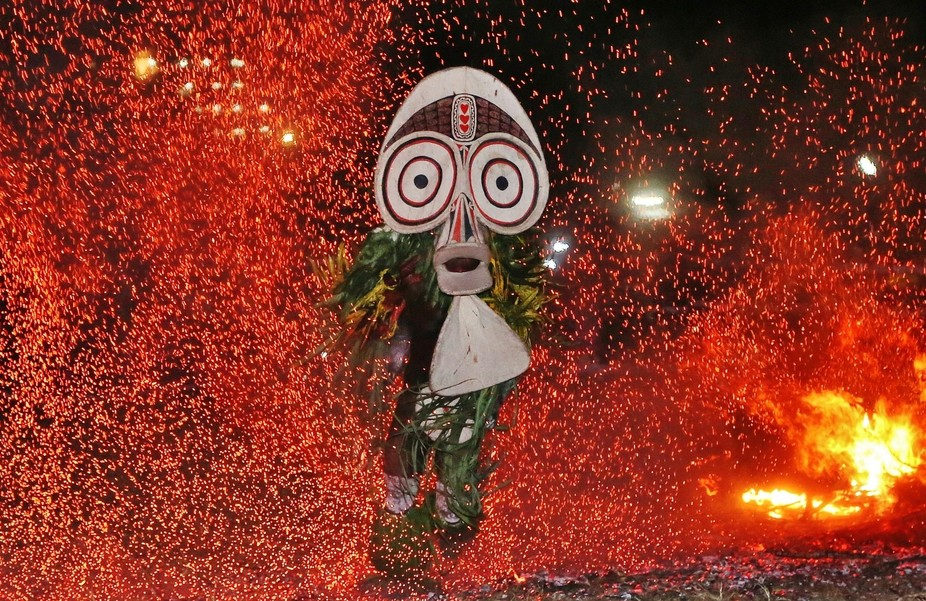 This is a photo of a Baining Fire Dancer performing a ritual dance which they have been doing for...