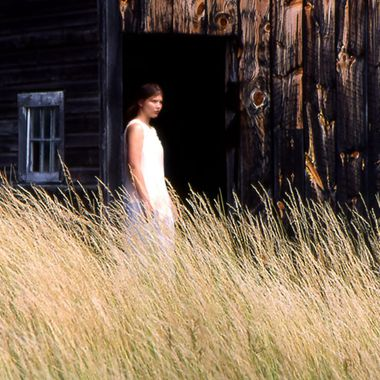 Discovered this old barn with tall grasses and had Teresa pose in a simple white dress.