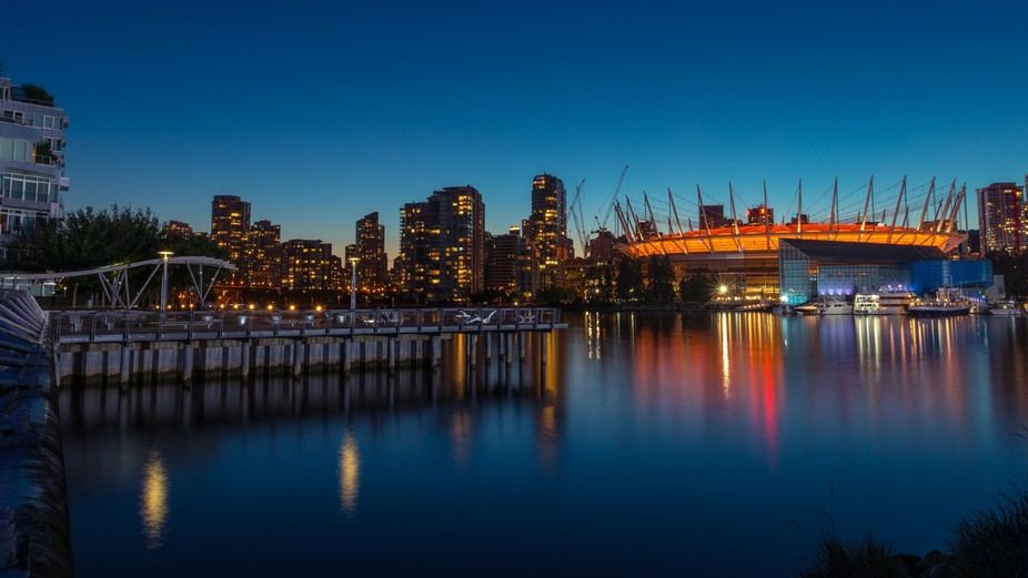 False Creek and BC Place Stadium in Vancouver BC at dusk.