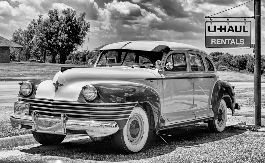 Beautiful Chrysler sitting for sale @ a U-haul.  I looked at this and thought how it hinted the c...