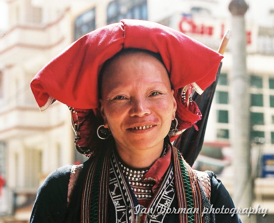 Red Hmong Lady in Sapa, Vietnam. She is clearly a wealthy lady as she has 3 gold teeth and lots of bling...the Hmong people are the indigenous people of Vietnam and are the treasure of and protected by the Vietnamese people. She charged me for the shoot and I was so happy to pay as she and her husband were just friendly.