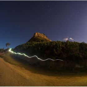 Full Moon light hike up Lions Head.  Stopped to catch my breath.  Took this long exposure and caught a headlamp trail light bouncing past