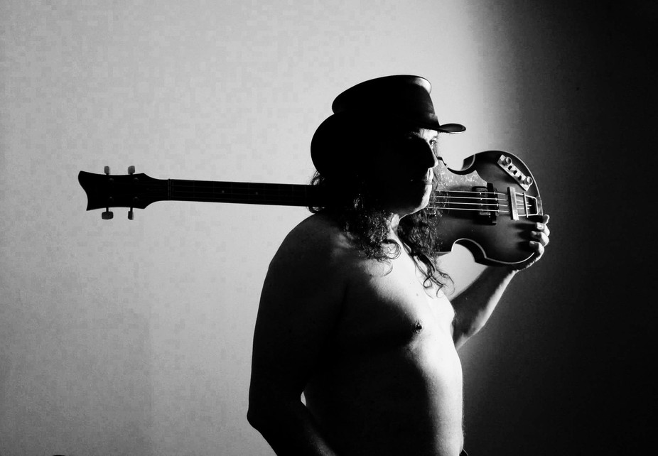 A portrait of my good friend/actor who is a huge Beatle fan, so he posed with the violin bass.