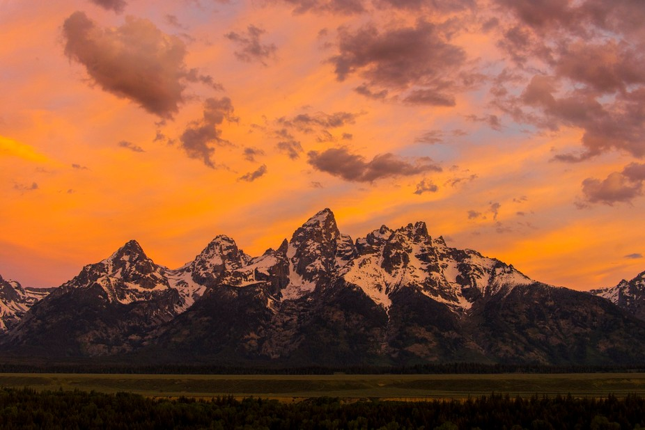 Spectacular sunrise over the Grand Teton Mountains.