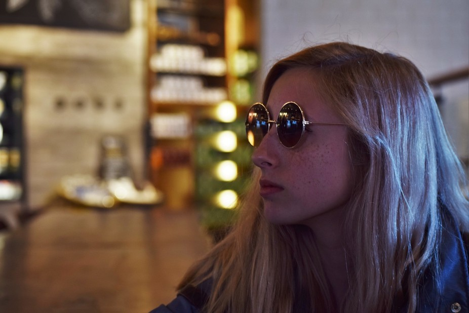 This photo is as snapshot of my friend rocking some really trendy glasses while waiting in Starbu...